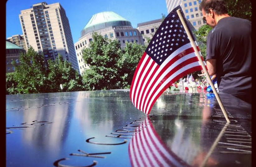 Mourners pay tribute to the victims of the 9/11 terror attacks (photo credit: ANNA HIATT)