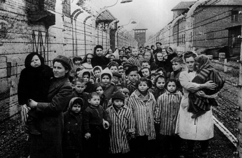 Holocaust survivors at Auschwitz. (photo credit: REUTERS)
