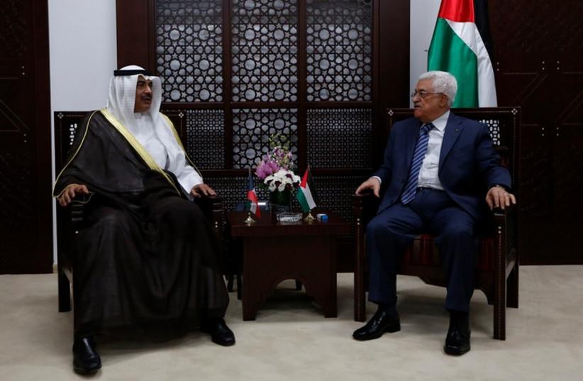 Palestinian Authority President Mahmoud Abbas meets Kuwait's Minister of Foreign Affairs Sheikh Sabah al Khalid al Sabah in Ramallah, September 14 (photo credit: REUTERS)