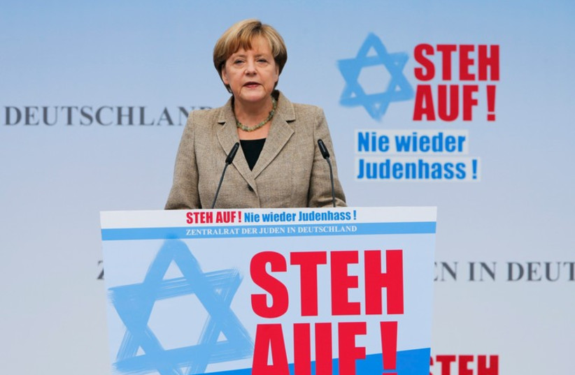 German Chancellor Angela Merkel makes an address during an anti-Semitism demo at Berlin's Brandenburg Gate September 14, 2014.  (photo credit: REUTERS)