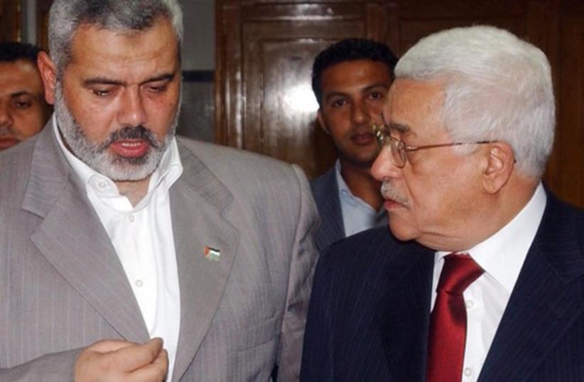 PA President Mahmoud Abbas and Hamas leader Ismail Haniyeh [file] (photo credit: REUTERS)