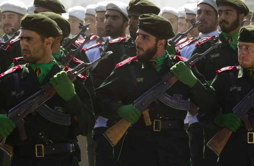 Members of Iran's Revolutionary Guards march during a parade to commemorate the anniversary of the Iran-Iraq war (1980-88), in Tehran September 22, 2010.  (photo credit: REUTERS)