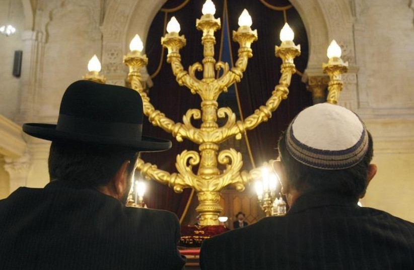 Members of the Jewish community at the synagogue in Bordeaux, southwestern France.  (photo credit: REUTERS)