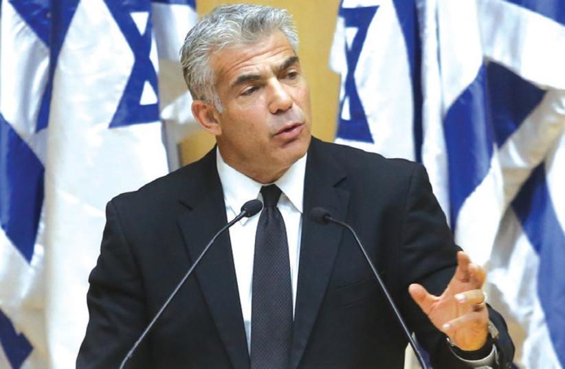 Finance Minister Yair Lapid (photo credit: MARC ISRAEL SELLEM/THE JERUSALEM POST)