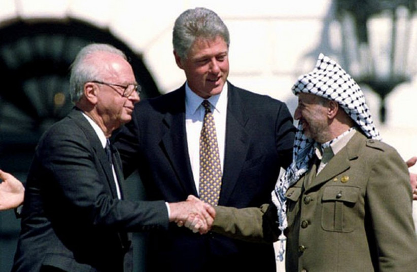 From left; Former prime minister Yitzhak Rabin, former US president Bill Clinton, and the late PLO leader Yasser Arafat on the White House lawn. (photo credit: REUTERS)