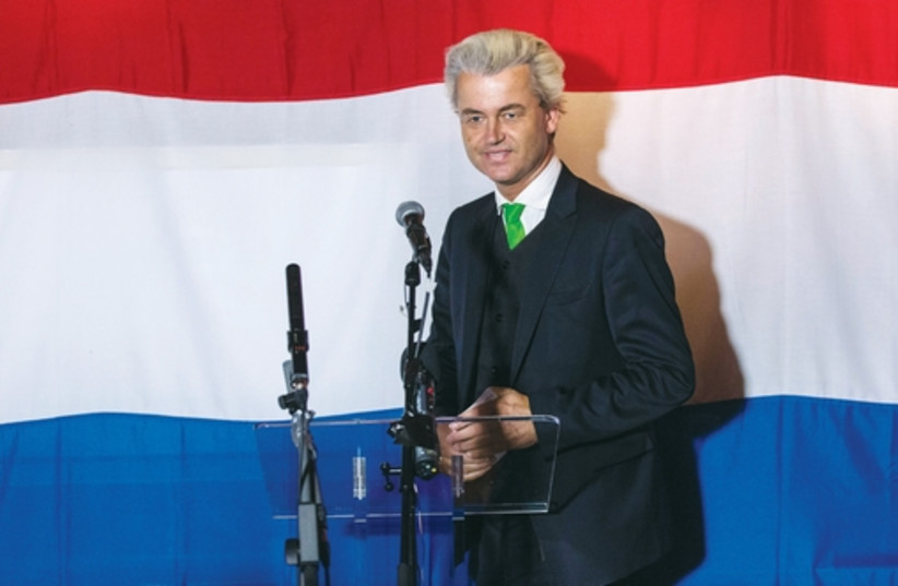 Far right dutch politician Geert Wilders of the antiimmigration Freedom (PVV) Party arrives at a PVV rally after the European Parliament elections. (photo credit: REUTERS)