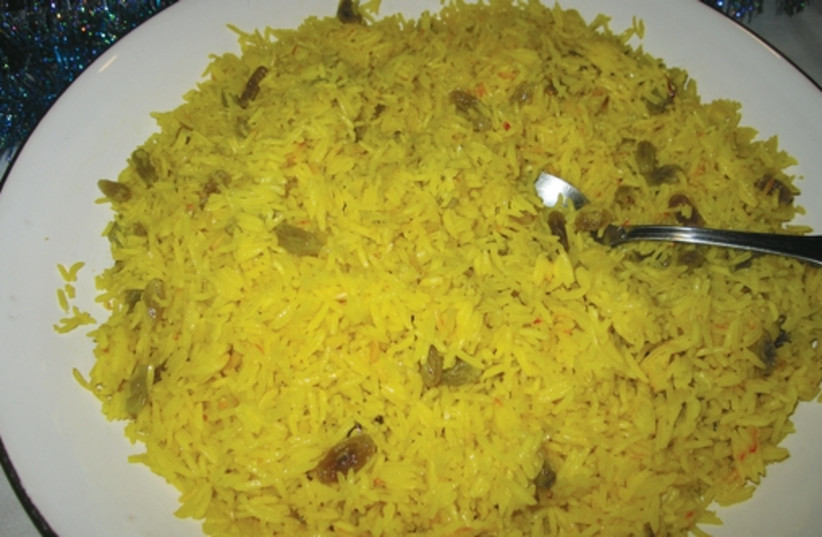 Yellow basmati rice mixes a savory taste with a sweet one by adding green raisins. (photo credit: YAKIR LEVY)