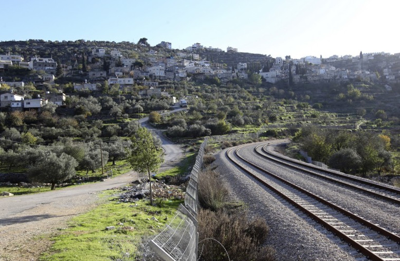 A train track running along the 1949 armistice line is seen near terraced agricultural fields in Battir village, south of Jerusalem (photo credit: REUTERS)