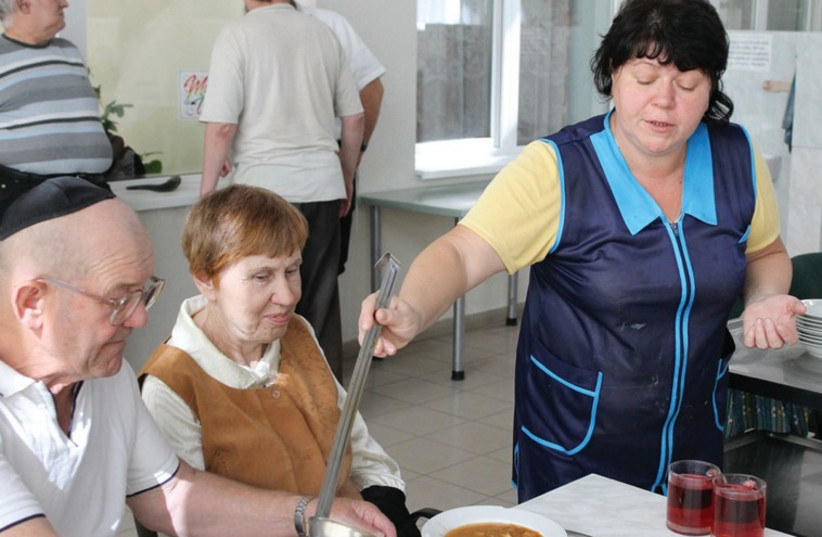 SOFIA AND Gregoriy Minyuck, who fled Donetsk, eat lunch at the Beit Baruch assisted living facility in Dnipropetrovsk, which now houses Jews displaced by the civil war. (photo credit: SAM SOKOL)