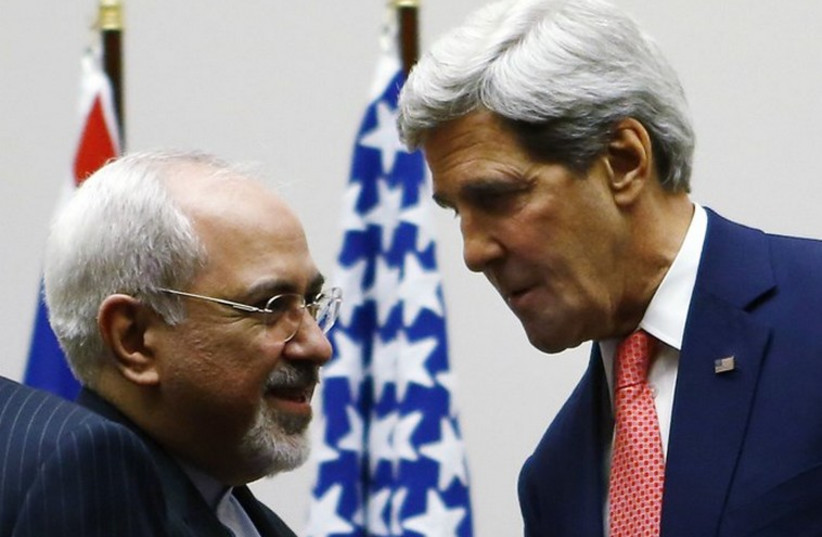 Iranian Foreign Minister Mohammad Javad Zarif (L) and US Secretary of State John Kerry (photo credit: REUTERS)