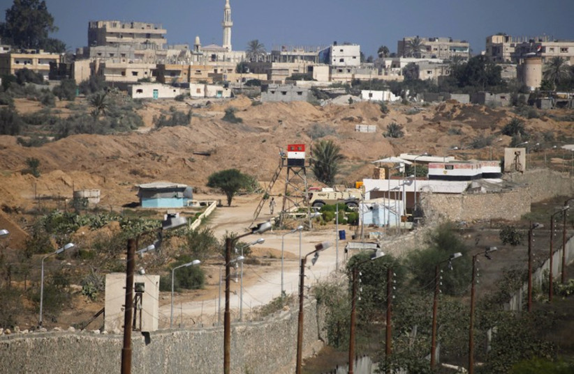 An Egyptian soldier keeps guard on the border between Egypt and southern Gaza Strip (photo credit: REUTERS)