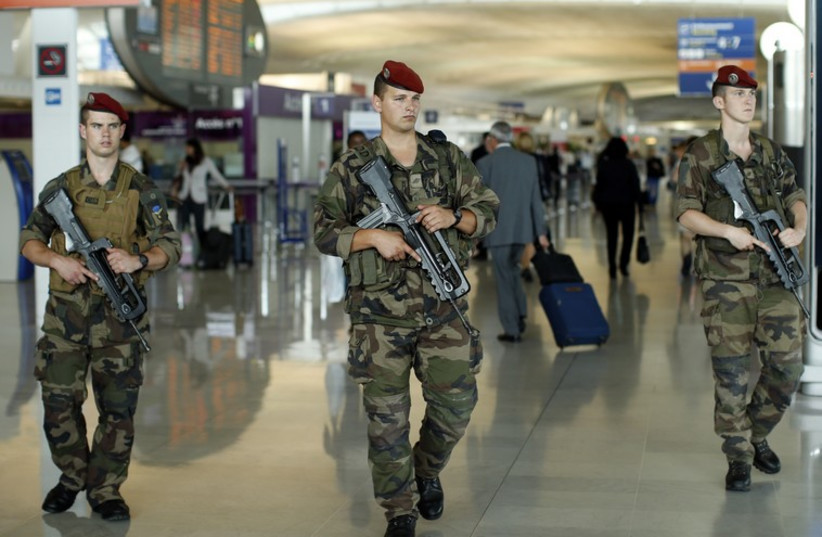French soldiers patrol through a terminal at the Charles de Gaulle International Airport (photo credit: REUTERS)