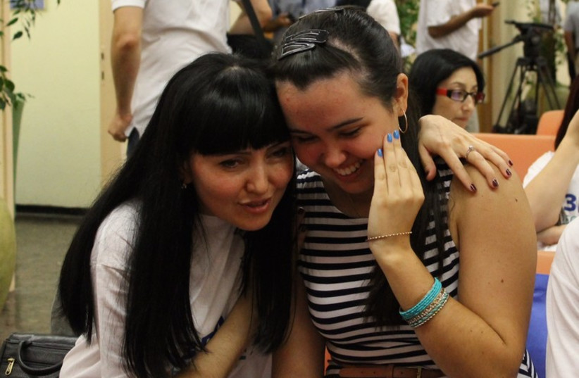Alexandrina Zheludev hugs her mother who escaped from Luhansk to meet her in Israel (photo credit: SAM SOKOL)