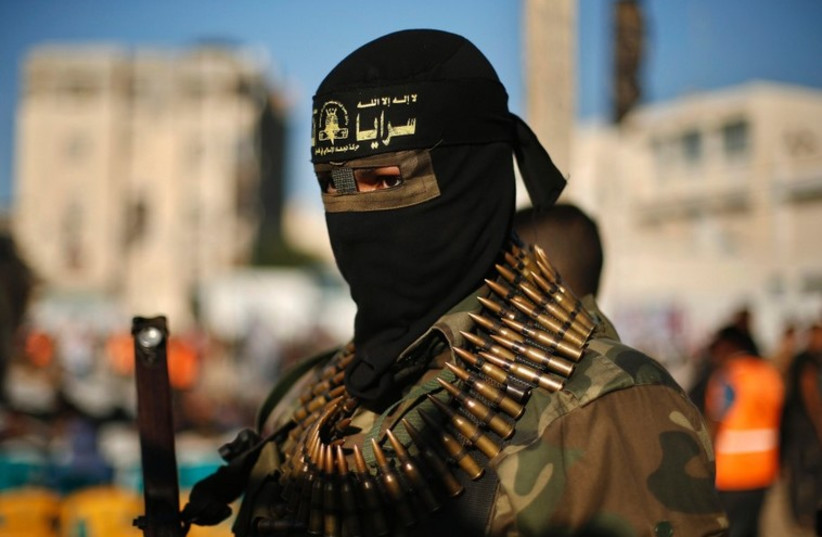 An Islamic Jihad militant attends an anti-Israel rally in Rafah. (photo credit: REUTERS)