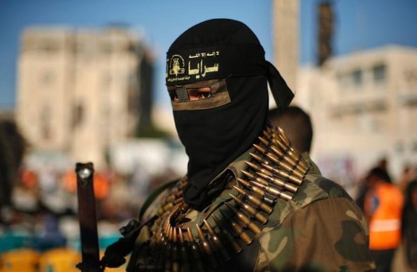 An Islamic Jihad militant attends an anti-Israel rally in Rafah. (photo credit: REUTERS)