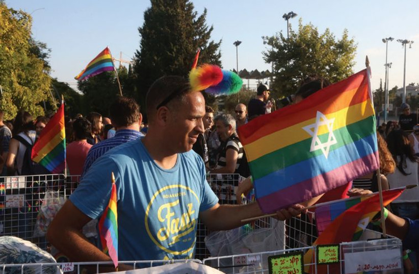 Celebrants march in the gay pride parade. (photo credit: MARC ISRAEL SELLEM/THE JERUSALEM POST)