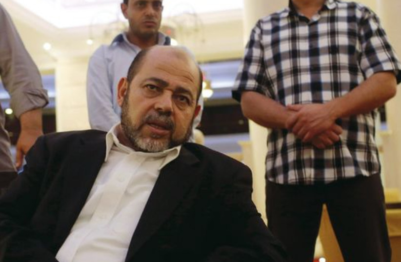 Deputy chairman of Hamas's political bureau Musa Abu Marzouk talks during an interview in Cairo on August 9. (photo credit: REUTERS)