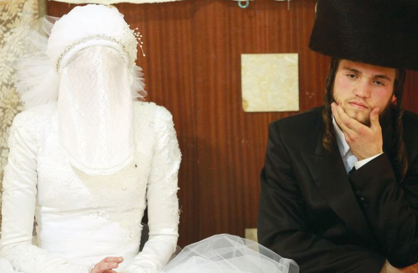 An Ultra-orthodox couple at their wedding in Bnei Brak. (photo credit: ILLUSTRATIVE: MARC ISRAEL SELLEM)