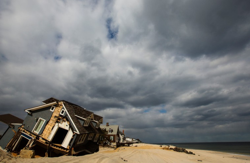 Climate change is believed by scientists to affect millions of people (photo credit: REUTERS)
