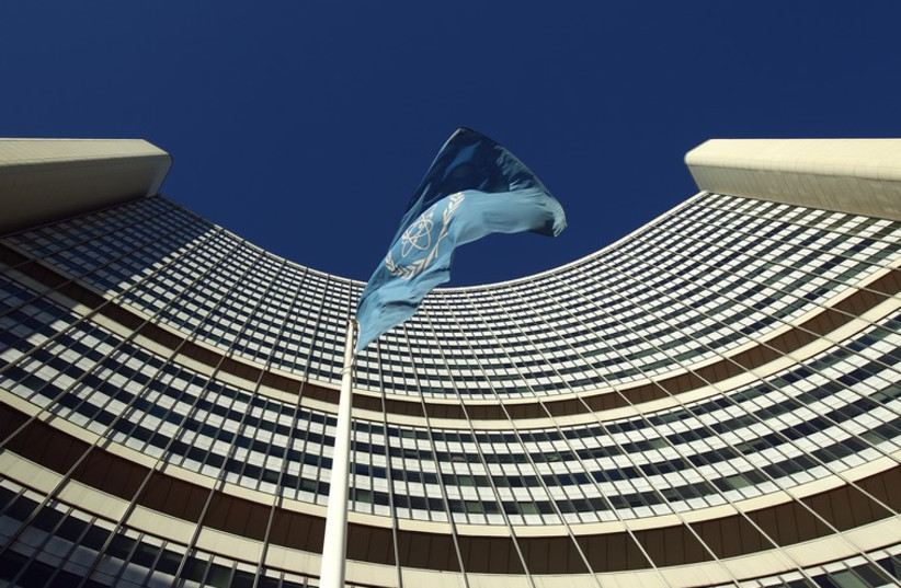 The flag of the International Atomic Energy Agency (IAEA) flies in front of its headquarters in Vienna  (photo credit: REUTERS)