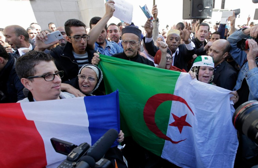 Muslims in Paris pay tribute to Herve Gourdel, a French mountain guide who was beheaded by an Algerian Islamist group. (photo credit: REUTERS)