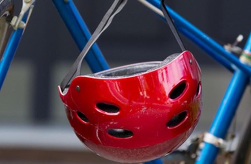 Bicycle and helmet [illustrative] (photo credit: INGIMAGE)