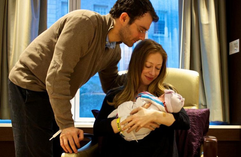 Chelsea Clinton with her new born baby Charlotte (photo credit: CHELSEA CLINTON'S TWITTER ACCOUNT)