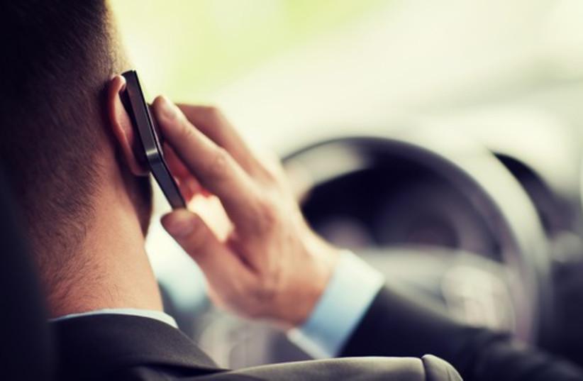 Man talking on mobile phone. (photo credit: INGIMAGE)