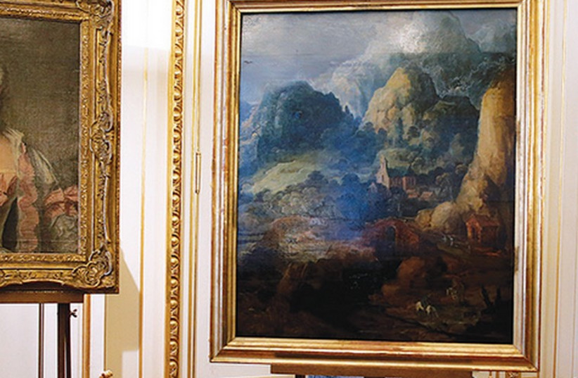 THREE PAINTINGS seized by the Nazis are displayed at an official ceremony in Paris March 11, 2014 (photo credit: REUTERS)