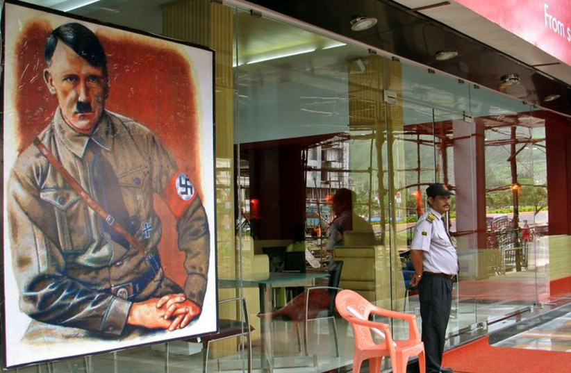 A security personnel stands guard outside a new restaurant, named after Adolf Hitler in Mumbai, India. (photo credit: REUTERS)