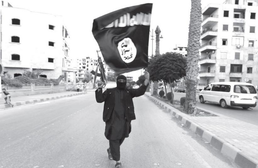 ISIS militant (photo credit: REUTERS)