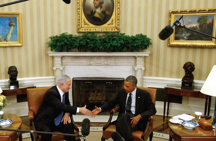Prime Minister Binyamin Netanyahu shakes hands with US President Barack Obama at the White House (photo credit: KEVIN LAMARQUE/REUTERS)