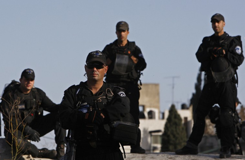Israeli security forces stand guard during a protest in east Jerusalem (photo credit: REUTERS)