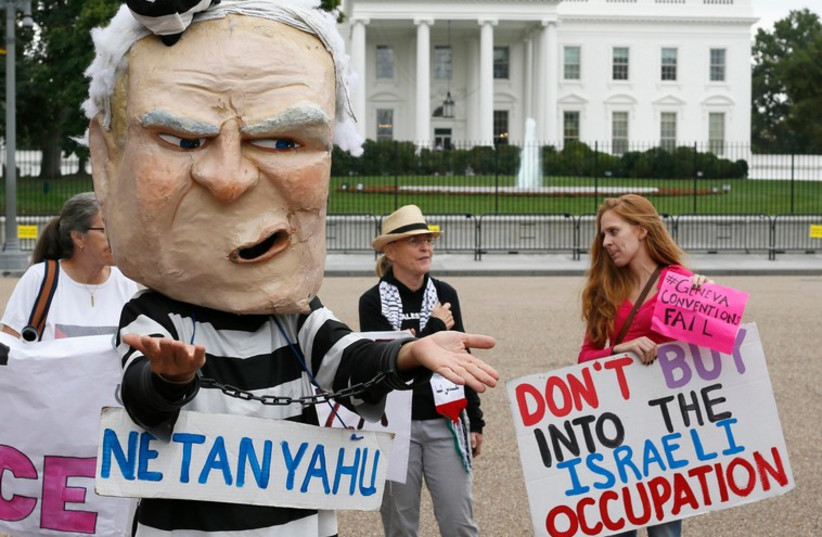 Protesters demonstrate against Prime Minister Binyamin Netanyahu during his meeting with US President Barack Obama at the White House (photo credit: REUTERS)