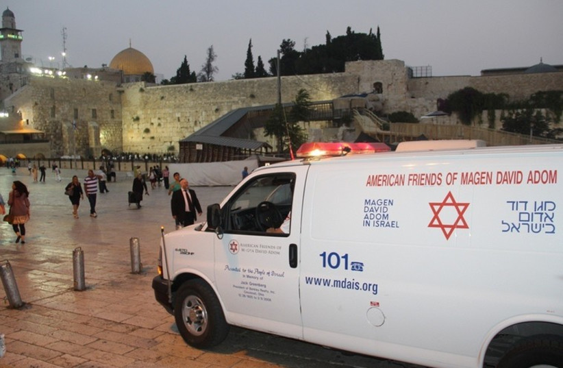 A Magen David Adom ambulance stands by near the Western Wall (photo credit: MAGEN DAVID ADOM)