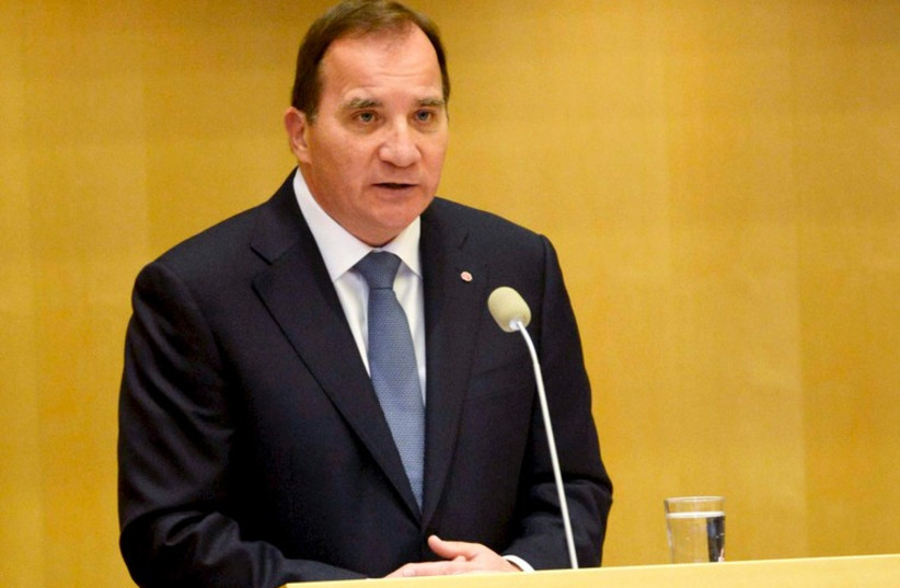Sweden's Prime minister Stefan Lofven announces his new government during a Parliament session in Stockholm October 3 (photo credit: REUTERS)