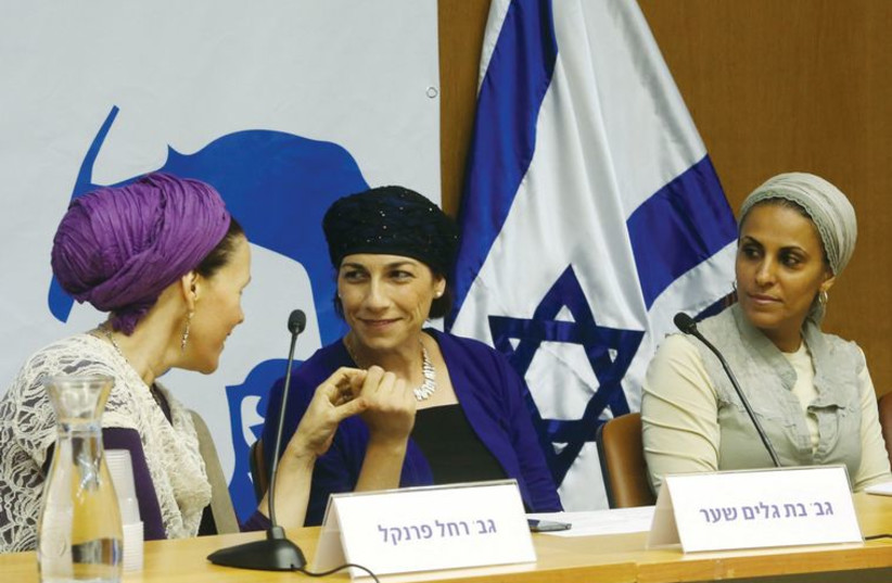 From left to right: Rachel Fraenkel, Bat-Galim Shaer and Iris Yifrah speak at the Knesset on June 25, five days before their son's were discovered near Halhoul. (photo credit: MARC ISRAEL SELLEM/THE JERUSALEM POST)