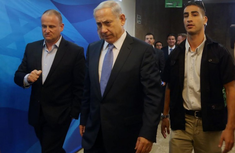 Prime Minister Benjamin Netanyahu enters cabinet meeting (photo credit: MARC ISRAEL SELLEM/THE JERUSALEM POST)