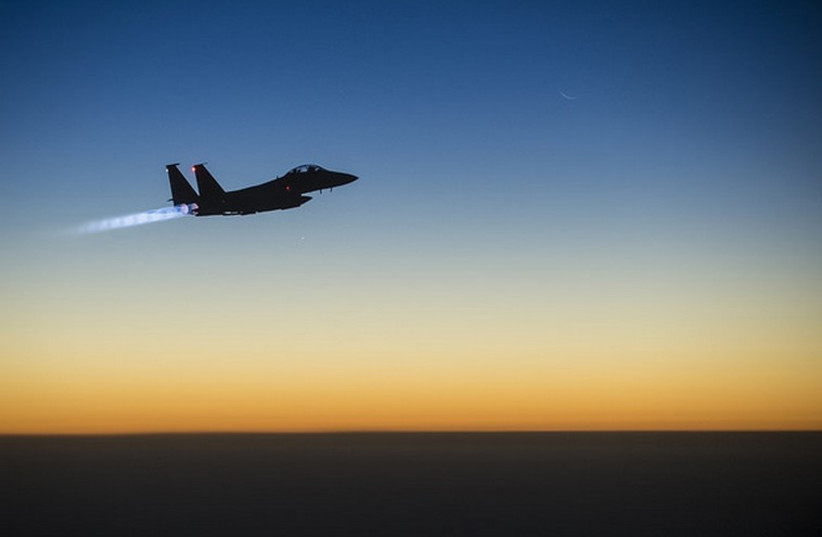 A U.S. Air Force F-15E Strike Eagle aircraft flies over northern Iraq Sept. 23, 2014,  (photo credit: US DEPARTMENT OF DEFENSE)