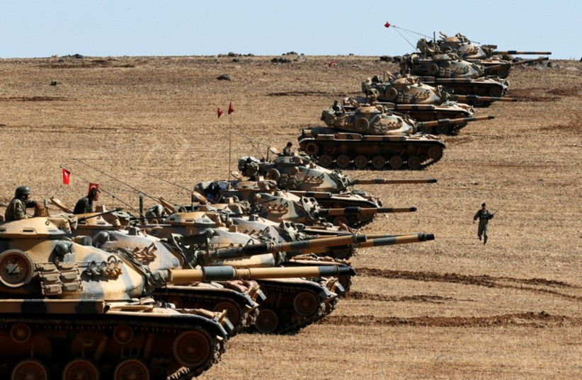 Turkish army tanks take up position on the Turkish-Syrian border near the southeastern town of Suruc in Sanliurfa province (photo credit: REUTERS)
