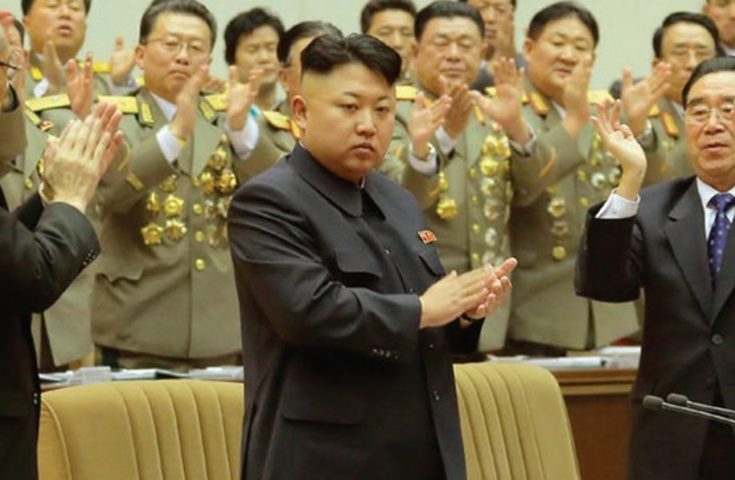 NORTH KOREAN leader Kim Jong Un applauds during the second day session of the 8th Conference of Ideological Officials of the Workers' Party of Korea (photo credit: REUTERS)