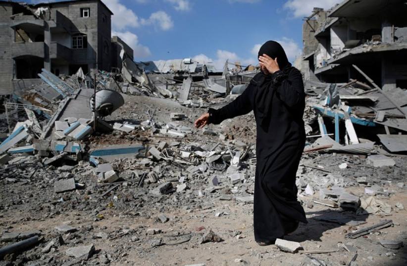 A Palestinian woman in the Gaza town of Beit Hanoun surveys the devastation (photo credit: REUTERS)