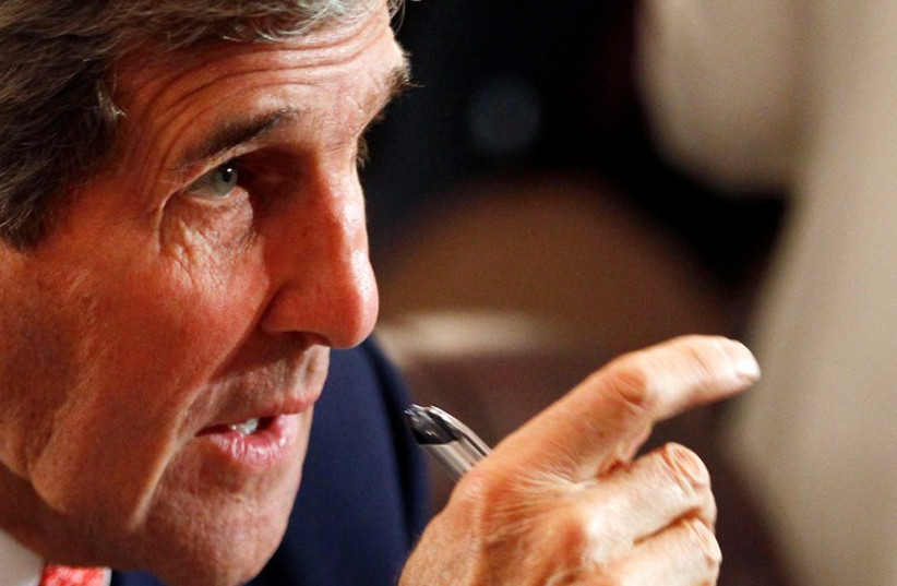 US Secretary of State John Kerry in Cairo at the Gaza donors conference (photo credit: REUTERS)