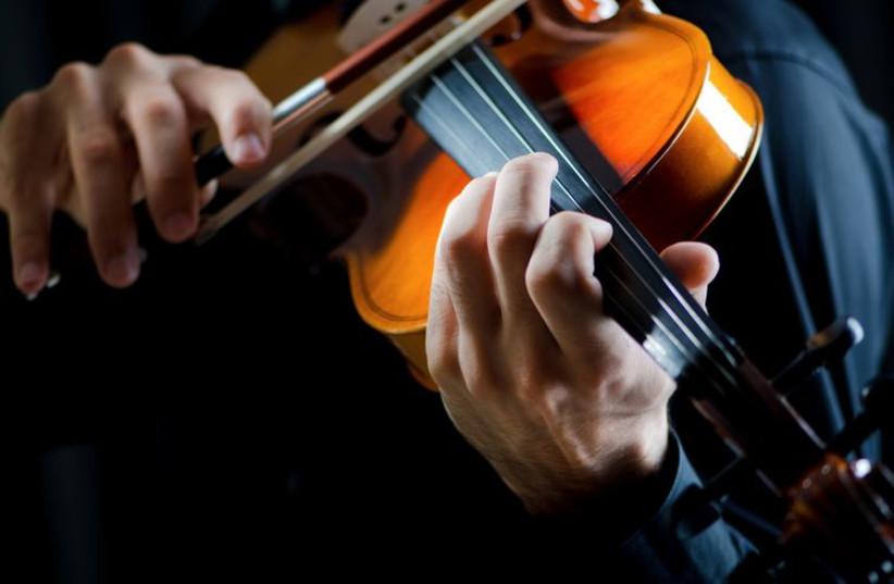 Violin player (illustrative photo) (photo credit: INGIMAGE)