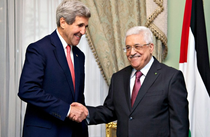 US Secretary of State John Kerry shakes hands with PA President Mahmoud Abbas in Cairo this week. (photo credit: REUTERS)