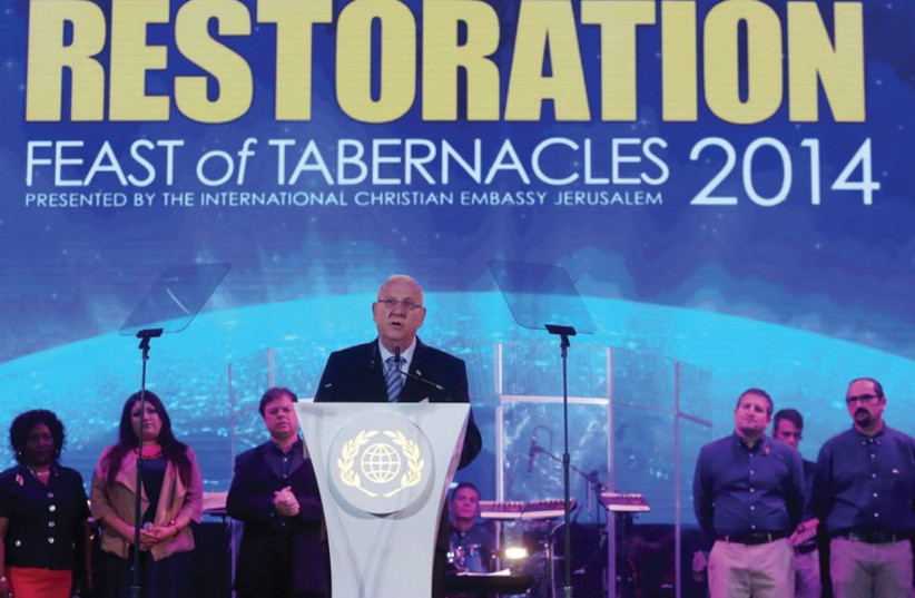 PRESIDENT REUVEN RIVLIN speaks at the Feast of Tabernacles Israeli guest night event, held at the Payis Arena in the capital yesterday. (photo credit: MARC ISRAEL SELLEM/THE JERUSALEM POST)