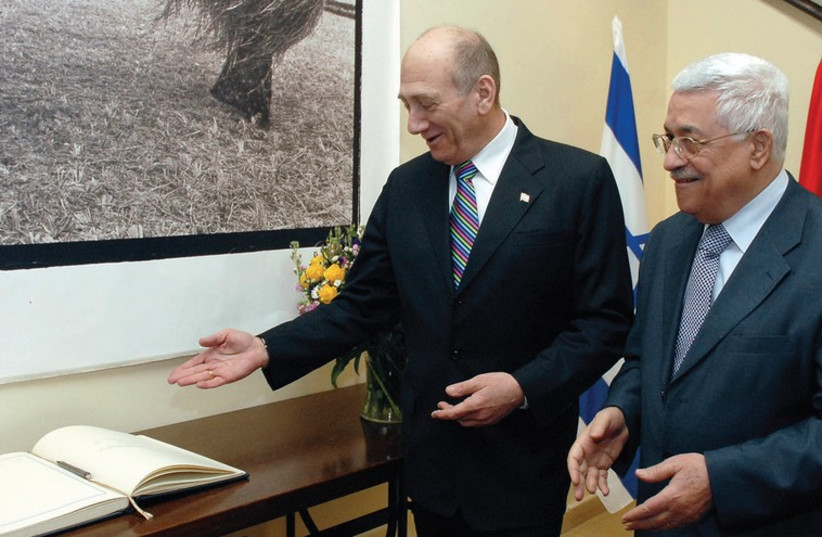THEN-PRIME Minister Ehud Olmert stands with Palestinian President Mahmoud Abbas during their meeting in Jerusalem in January, 2008 (photo credit: REUTERS)