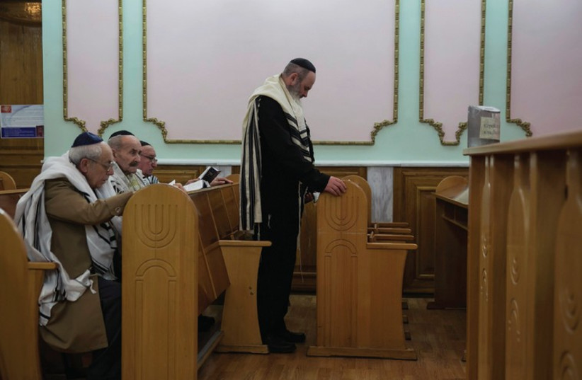 JEWS ATTEND the morning prayer at a synagogue in Donetsk, eastern Ukraine, earlier this year (photo credit: REUTERS)