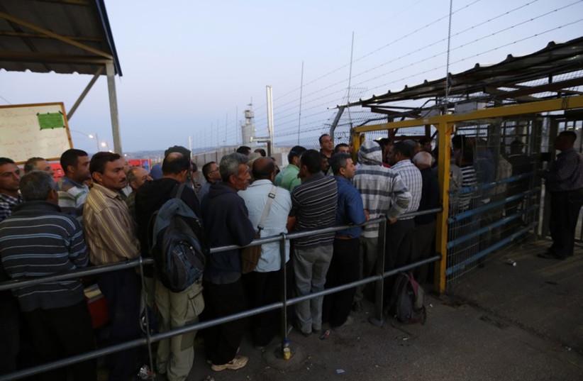 Palestinians wait to cross into Israel at Jalama crossing near Jenin  (photo credit: REUTERS)