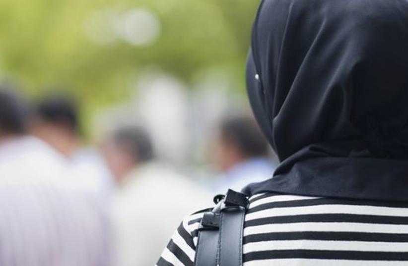 A woman wearing a hijab [Illustrative] (photo credit: INGIMAGE)
